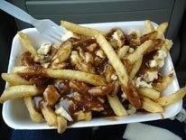 Is poutine Canada's national food? Two arguments for, two against
