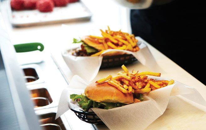 Freshly prepared burgers at The Burger's Priest