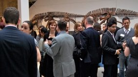 ROM Young Patrons gather among the dinosaurs to give out first research fund award