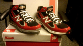 Jose Bautista accepts his ruby slippers from New Balance