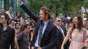 TIFF PHOTO GALLERY: Gerard Butler delights his fans with ridiculous antics at the Machine Gun Preacher red carpet gala