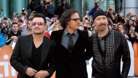 TIFF PHOTO GALLERY: Bono and The Edge walk the red carpet at Roy Thomson Hall for Davis Guggenheim's From the Sky Down