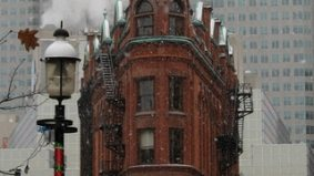 The triangular five-story redbrick building—the Flatiron—is officially on the market