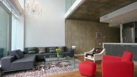 Condomonium: $795,000 for a sub-penthouse suite in Seventy5 Portland, with common space designed by Philippe Starck