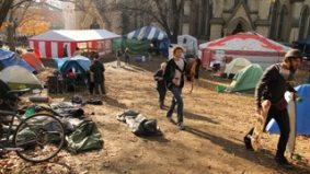 Occupy Toronto gets its marching orders; police take a hands-off approach to the eviction