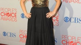 POLL: Elisha Cuthbert wears Canadian to the People's Choice Awards, but does she do it justice?