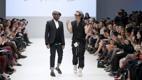 Ezra Constantine pulls back on the black draped jersey at Toronto Fashion Week