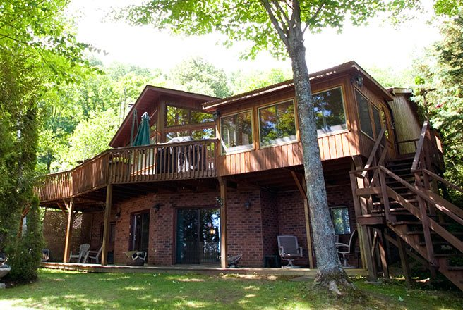 Cottage of the Week: $600,000 for a lakefront cabin with a wraparound porch in the Hastings Highlands