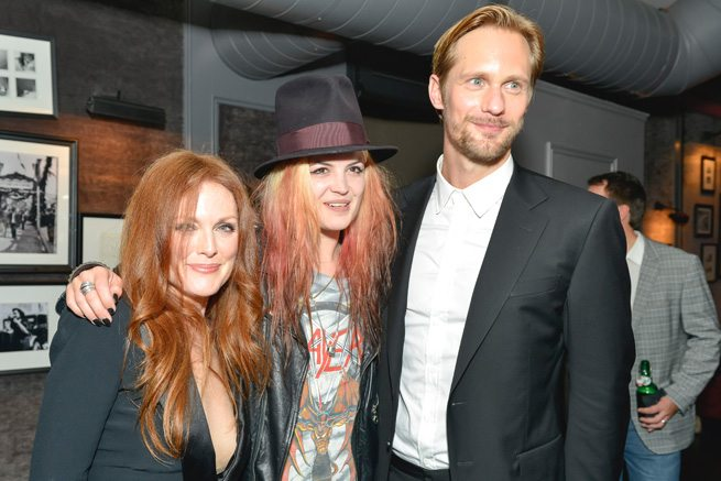 TIFF PARTY: Alexander Skarsgård loves 'em and leaves 'em at the after-party for What Maisie Knew