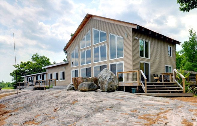 Cottage of the Week: $975,000 for a lakefront cabin with two kitchens, two living rooms and one massive loft
