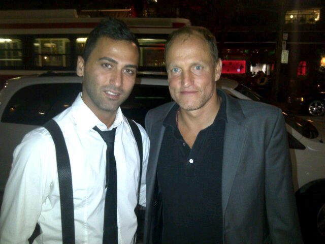 SPOTTED: Woody Harrelson obliging a fan with a photo op on King West
