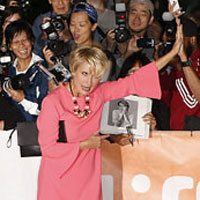 TIFF GIF: Emma Thompson gives one lucky fan some skin-to-skin contact