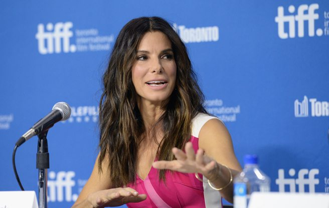 Sandra Bullock talks uncomfortable contraptions and George Clooney's tiki bar at the presser for Gravity