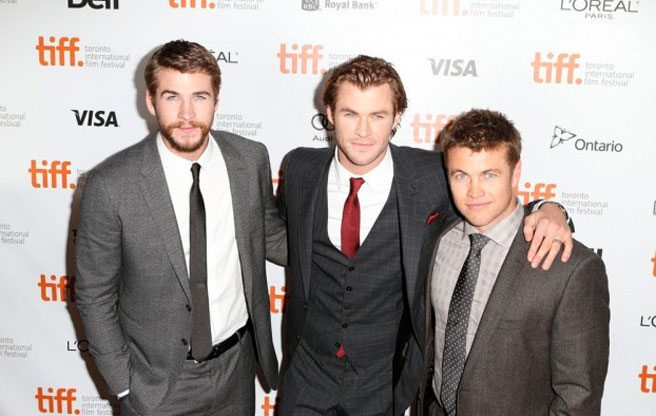 The uber-hunky Hemsworth bros keep it all in the family at TIFF