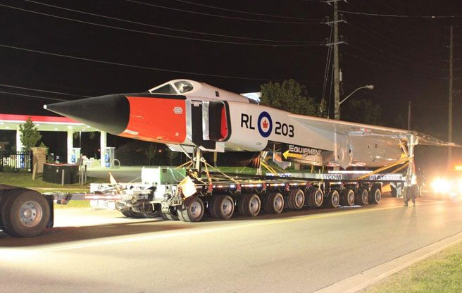 PHOTO: a midcentury fighter jet travels the streets of Toronto