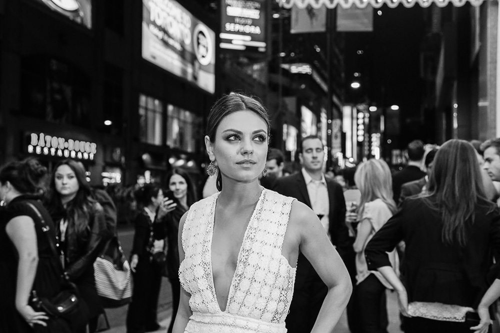 TIFF Red Carpet: Mila Kunis's plunging neckline and Liam Neeson's dramatic exit at the Third Person premiere