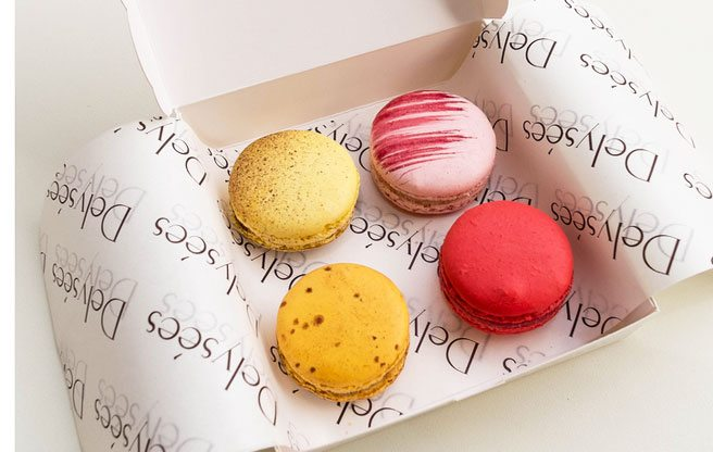 Multicoloured macarons and other mini-confections at a new patisserie on King West