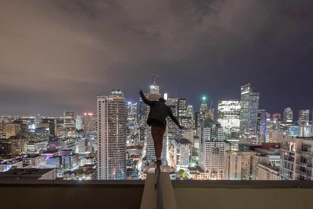SLIDESHOW: 13 heart-stopping photos from a man who dangles off Toronto skyscrapers in the name of art