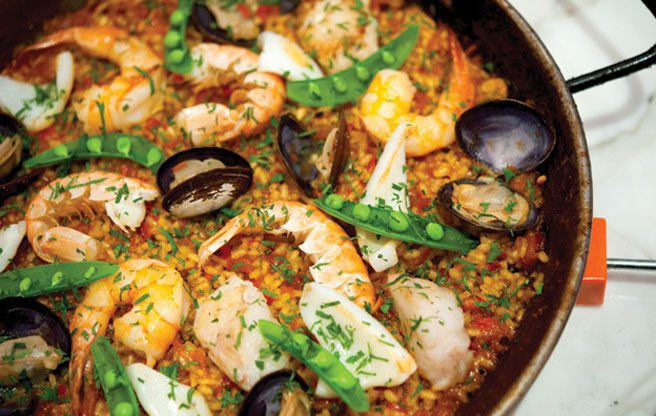 Patria is giving away free paella and churros tonight