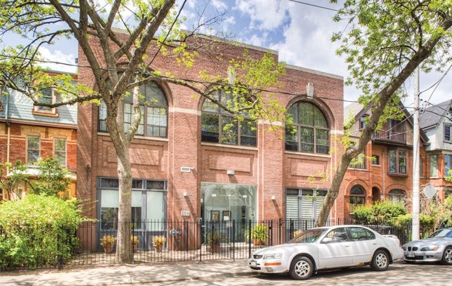 Condo of the Week: $760,000 for a two-level loft in Moss Park with a spiral staircase and a trap door