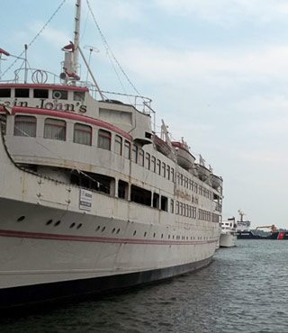 The guy who bought Captain John's restaurant boat has finally paid up