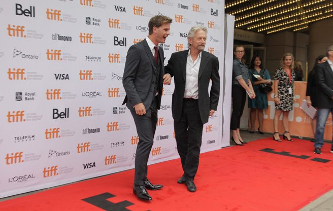 Michael Douglas and Jeremy Irvine get pally at the premiere of human-sport-hunting thriller <em>The Reach</em>