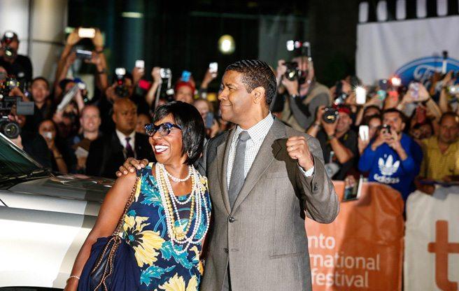 Denzel Washington wreaks charming vengeance on the red carpet for <i>The Equalizer</i>