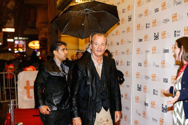 Bill Murray gets caught in a downpour at his <em>St. Vincent</em> premiere