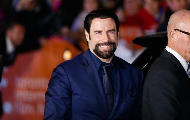 John Travolta shakes almost too many hands at the premiere of <em>The Forger</em>