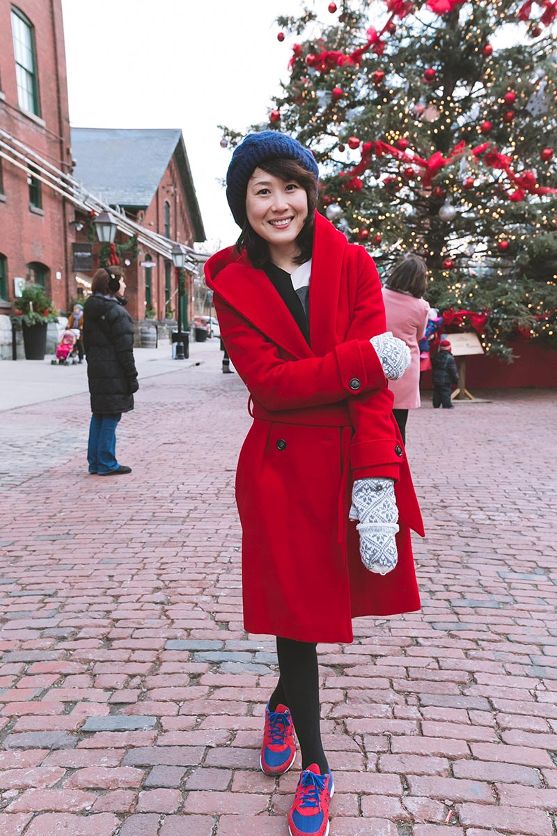 Street Style: visitors show off chunky knits and statement coats at the Distillery's Christmas Market
