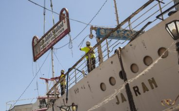 Workers take away the Captain John's sign