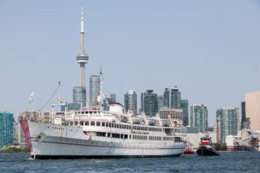 Captain John's is towed into Lake Ontario