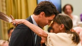 Justin Trudeau will be the prime minister of hugs