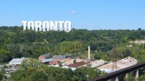 """A marketer says these renderings of big """"Toronto"""" signs are proof the city owes him $2.5 million"""