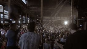 "Watch Rufus Wainwright and a 1,500-voice choir sing ""Hallelujah"" in an abandoned power plant"