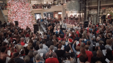 "Watch a 2,000-voice choir sing ""What a Wonderful World"" in the Eaton Centre"