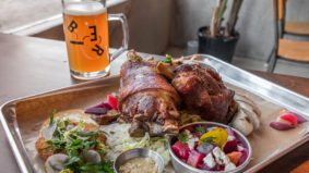 What's on the menu at Otto's Bierhalle, a German beer hall with 24 brews on tap