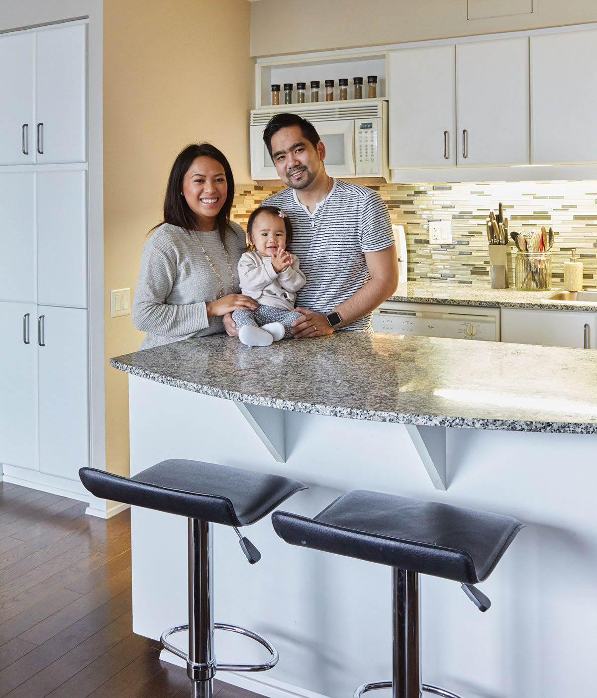 Elaine and James Evangelista and their 10-month-old daughter, Kara Elise, at Radiance Condos