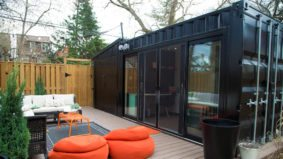 A couple solved their home-office quandary by plunking a shipping container in their backyard