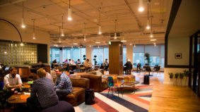Inside WeWork's new 35,000-square-foot co-working space in Yorkville, with an office bar and plenty of retro touches