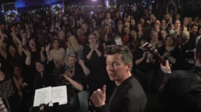 "Watch Rick Astley sing ""Never Gonna Give You Up"" with a 200-person choir in Toronto"
