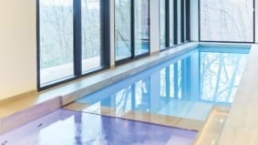 This Rosedale mansion's indoor swimming haven has treetop views