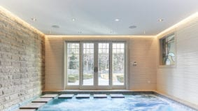 This candy magnate's indoor pool has its own miniature waterfall