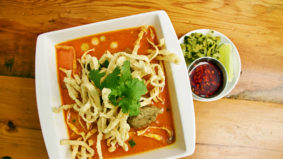 Here's how much it actually costs to make the khao soi at Khao San Road