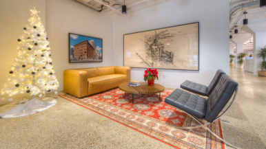 Inside developer Hullmark's downtown office, with a celebration gong and Shepard Fairey artwork