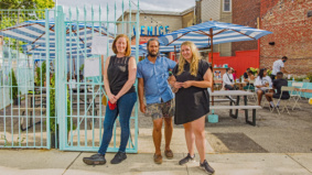 Beach umbrellas, boozy slushies and barbecued burgers: How a group of Toronto business owners turned a parking lot into a tropical paradise