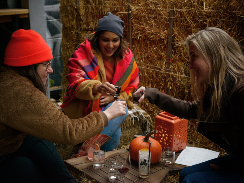 Hay bales, hot drinks and heat lamps: This secret patio behind a secret bar is serving up boozy cocoa and fall-on-the-farm feels