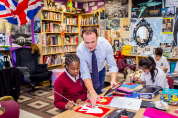 Teacher and student in a classroom at Unionville Montessori